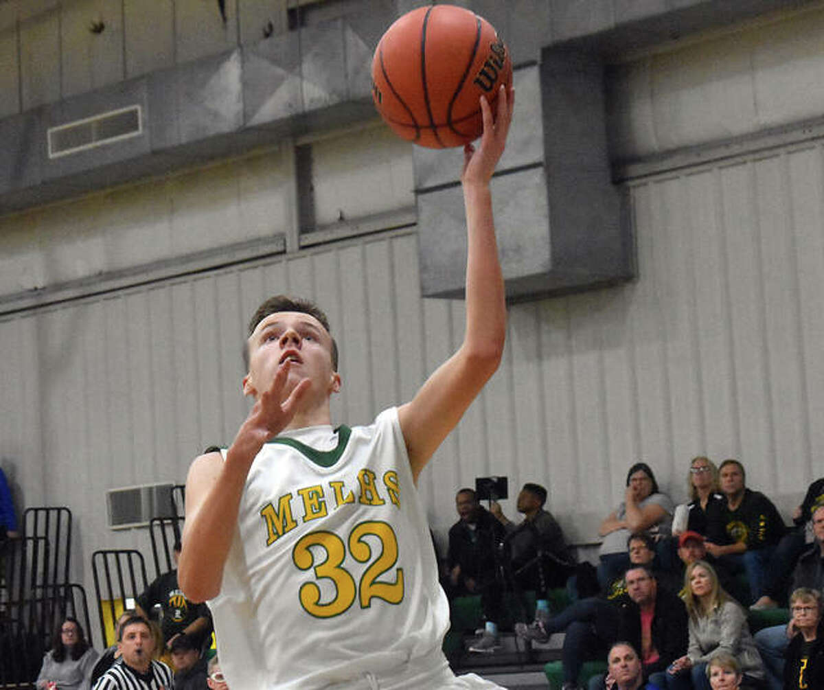 Metro-East Lutheran's Elliott Wilson goes in for a layup in the first quarter.