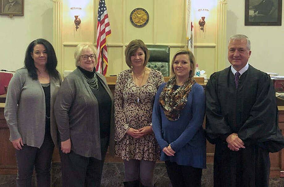 New Morgan County Court Appointed Special Advocates were sworn in Thursday by Judge Jeffery Tobin (right). Volunteers are Gina Hayes (from left), Lynnda McCorkle, Lisa Haden and Ashlen Miller. Photo: Photo Provided