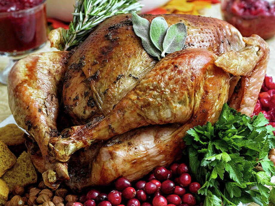 Food safety experts say raw turkeys shouldn't be rinsed, because that can spread harmful bacteria. Cooking should kill any germs. But bacteria still can spread in other ways, so washing and sanitizing hands and surfaces remains important. Photo: Larry Crowe   Associated Press