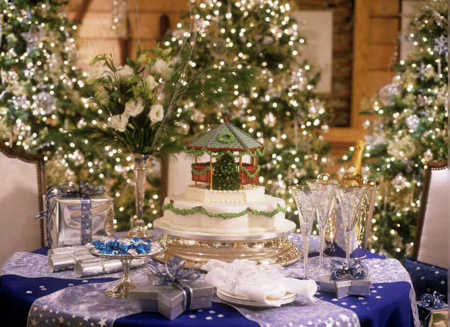 Trudy Dujardin, owner of interior design firm Dujardin Design, with offices in Westport and Nantucket, created this spectacular holiday table, which blends elements of both Hanukkah and Christmas. Photo: Erik Rank / / Connecticut Post