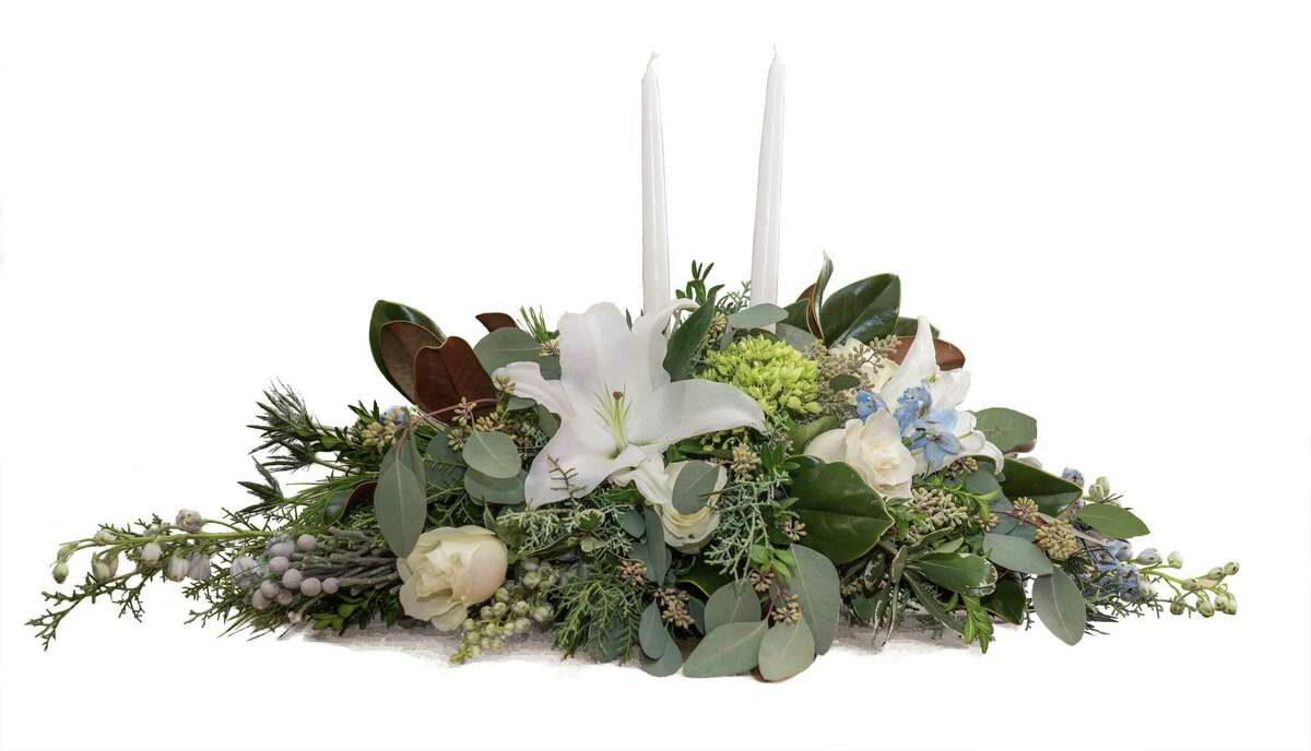 This seasonal arrangement with its winter design elements, designed by the designers at Bruce's Flowers in Norwalk and Hansen's Flower Shop in Fairfield, both owned by Bruce Minoff, would be appropriate for virtually any holiday table.