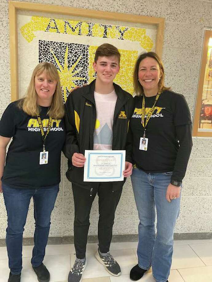 Amity Regional High School counselor Marian Boyns, second-place essay contest winner Nolan Young and Amity Principal Anna Mahon. Photo: Julianne Alberty / Volunteer Square