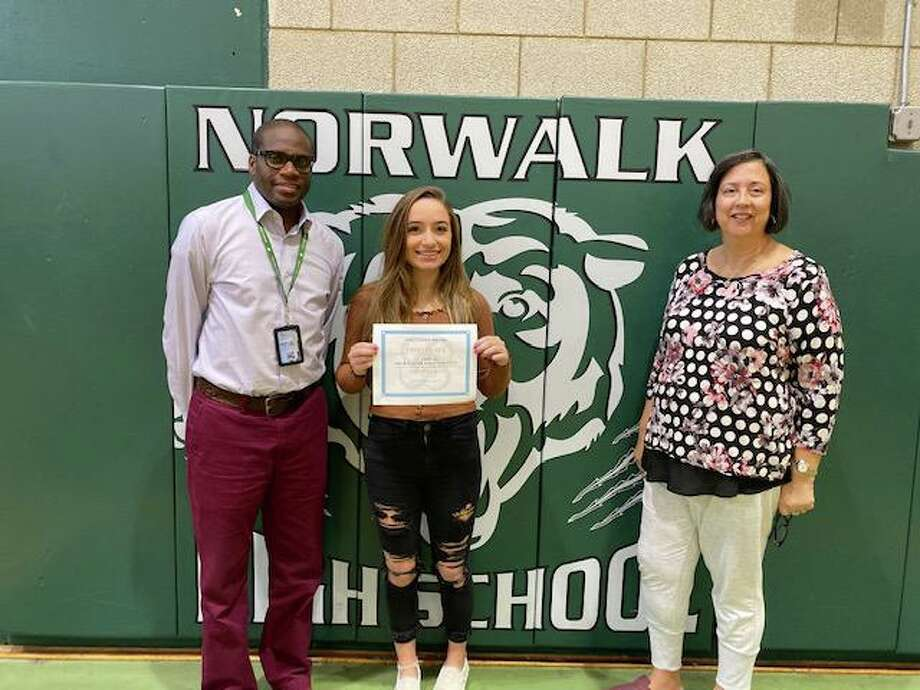 Norwalk High School Principal Reginald Roberts, first-place essay contest winner Tabitha Baker and school counselor Yvonne Berrios. Photo: Julianne Alberty / Volunteer Square