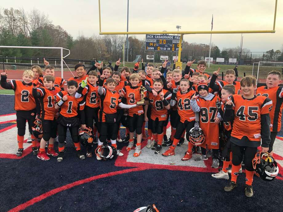 Ridgefield celebrates after winning the Fairfield County Football League's fifth grade division championship. Photo: Contributed Photo / Ridgefield Youth Football