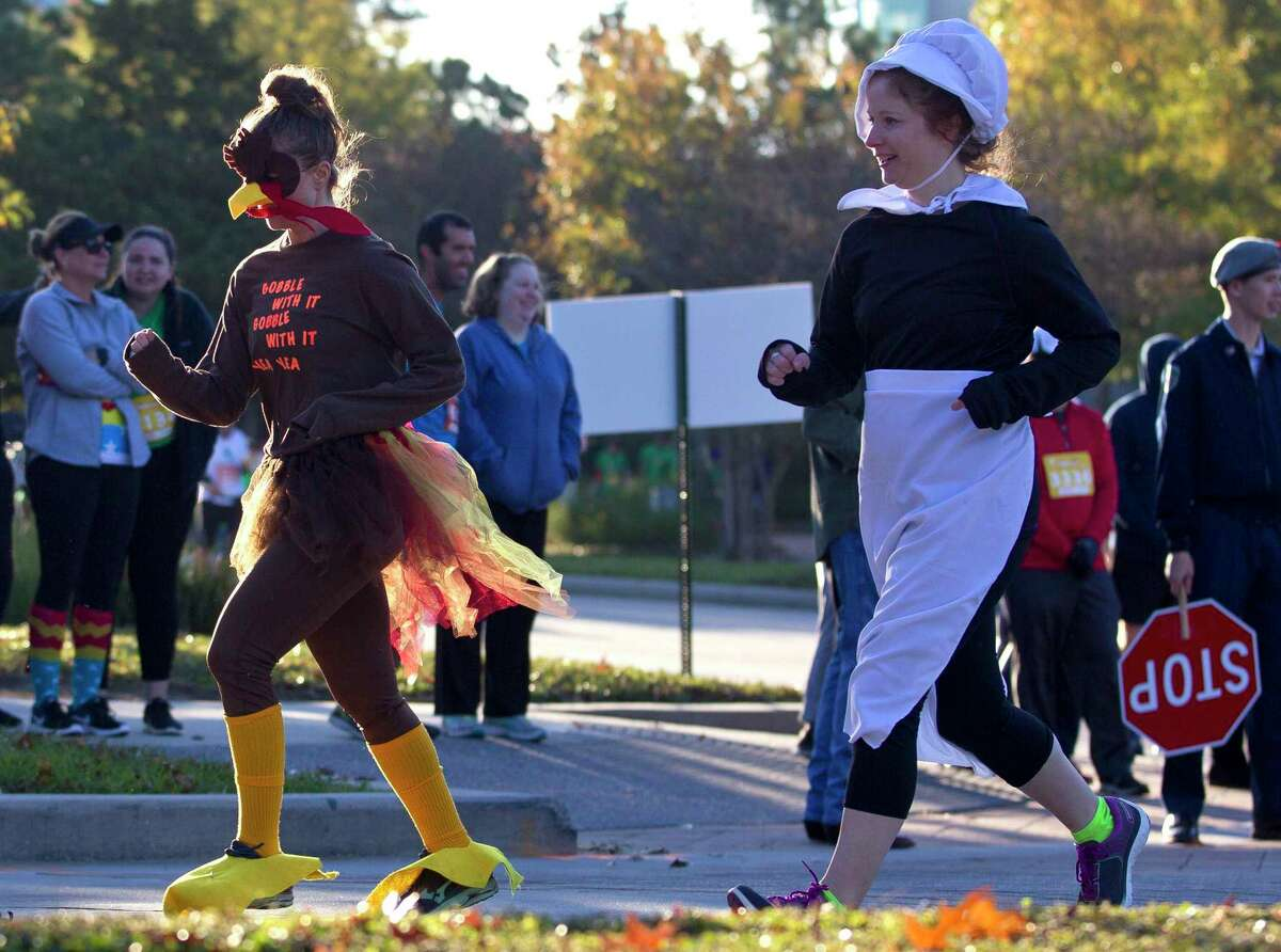 The 2020 YMCA Run Thru The Woods fun run has been canceled. Denise Smith, left, and Sarah Klepper dress as a turkey and pilgrim respectively as they take part in the annual YMCA Run Thru the Woods with family and friends on Thanksgiving, Thursday, Nov. 23, 2017, in The Woodlands.