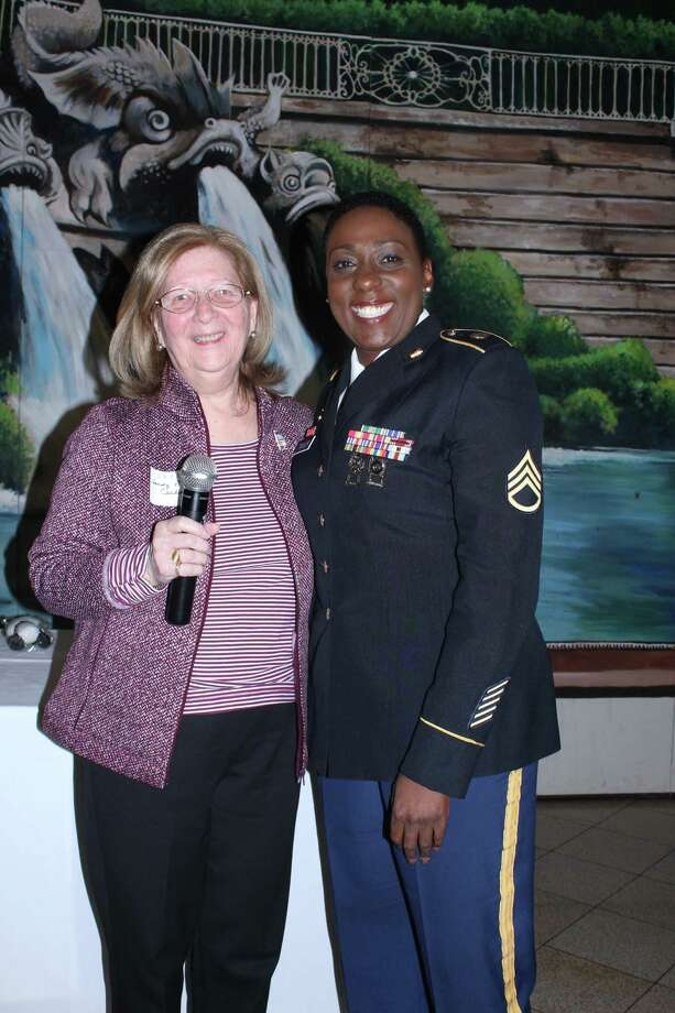 First Vice President Sandra Petrucelli-Carbone of the Greater Bridgeport Retired Teachers Association (GBRTA), introduces the November guest speaker, retired Staff Sergeant Juliet Taylor, at the annual luncheon meeting to honor veterans. The meeting was held at Testo's Restaurant in Bridgeport on Nov. 14. Photo: Contributed Photo