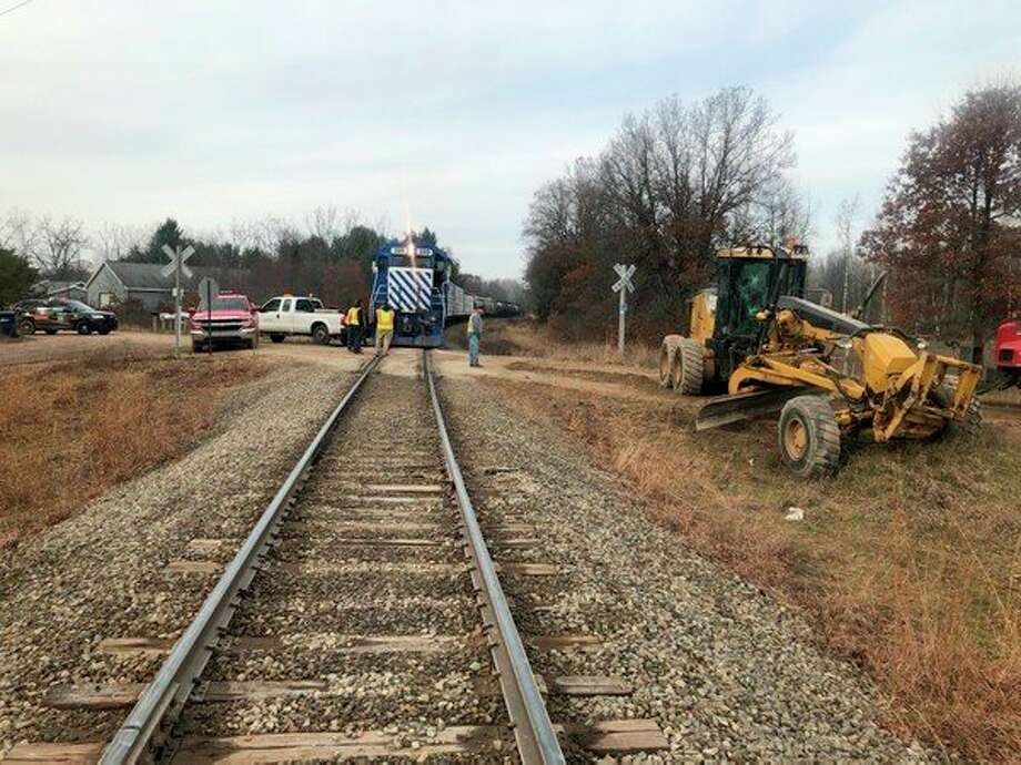Osceola County Sheriff's Office deputies responded to an incident shortly before 11:30 a.m. on Monday involving an Osceola County road grader which was hit by a train on 17 Mile Road and Ashland Drive in Middle Branch Township. The driver of the road grader reportedly was treated at the scene for minor injuries and released. (Courtesy photos/Osceola County Sheriff's Office)