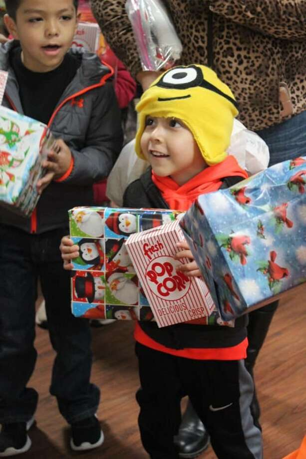 Children receive gifts at Midland Soup Kitchen Ministry Christmas event. Photo: Courtesy Photo