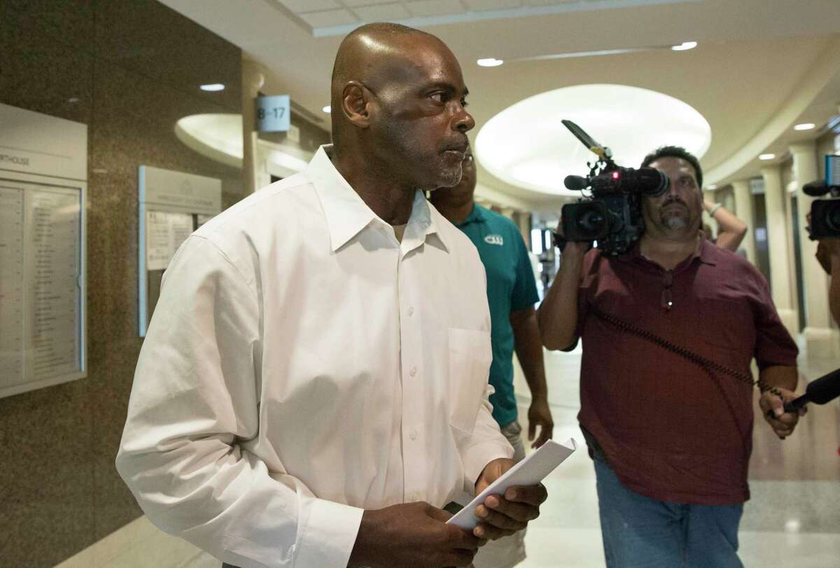 Former Houston Police Department narcotics officer Gerald Goines leaves the courtroom after appearing to Harris County Judge Frank Aguilar on Monday, Aug. 26, 2019, in Houston. Goines was is charged with felony murder in deaths of Dennis Tuttle and Rhogena Nicholas Steve in a botched drug raid in Januray.