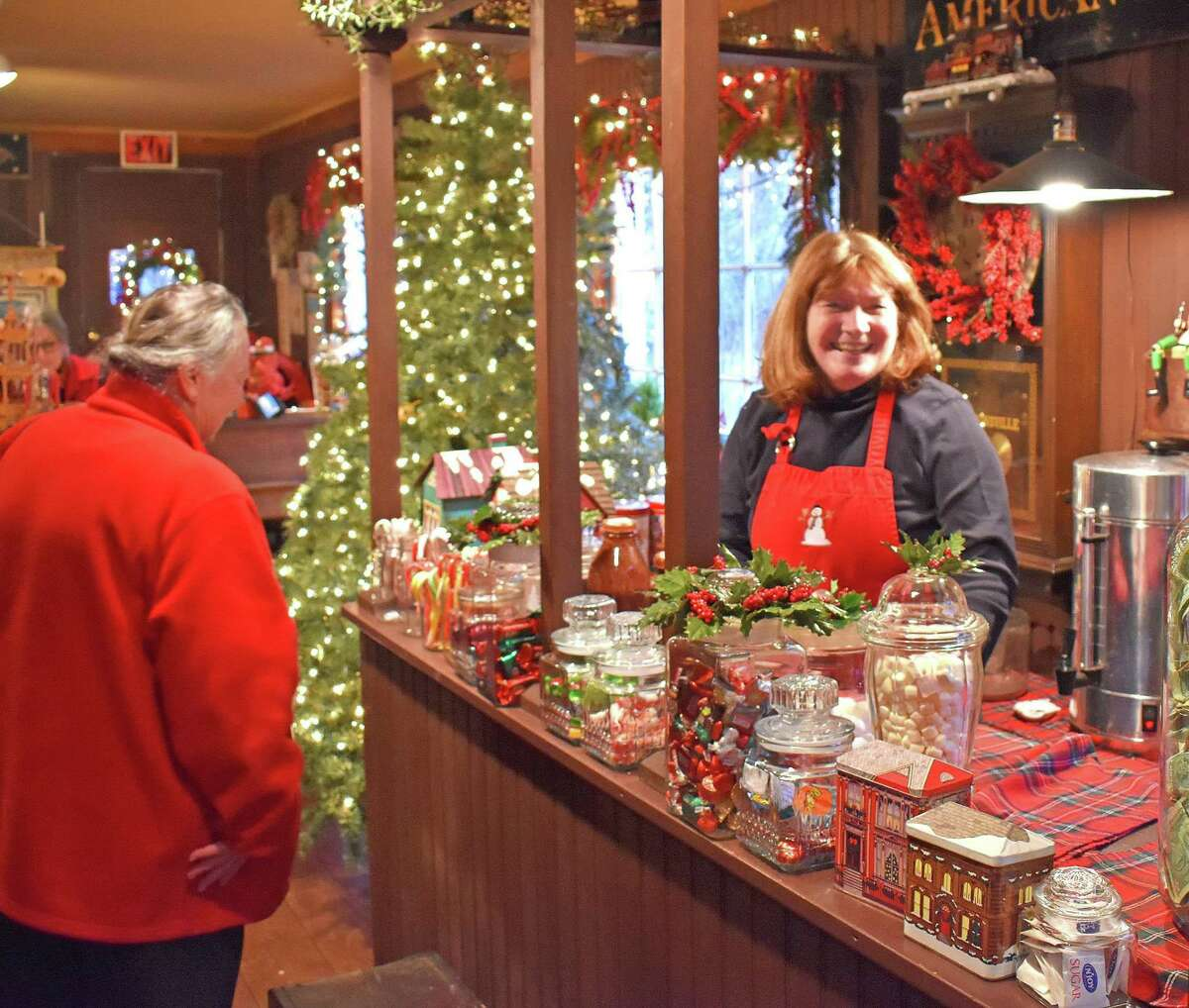 Georganne Bensh, the driving force behind the Christmas show at Merwinsville Hotel in Gaylordsville, is shown above at last year's festive event. This year's event will open Nov. 29.