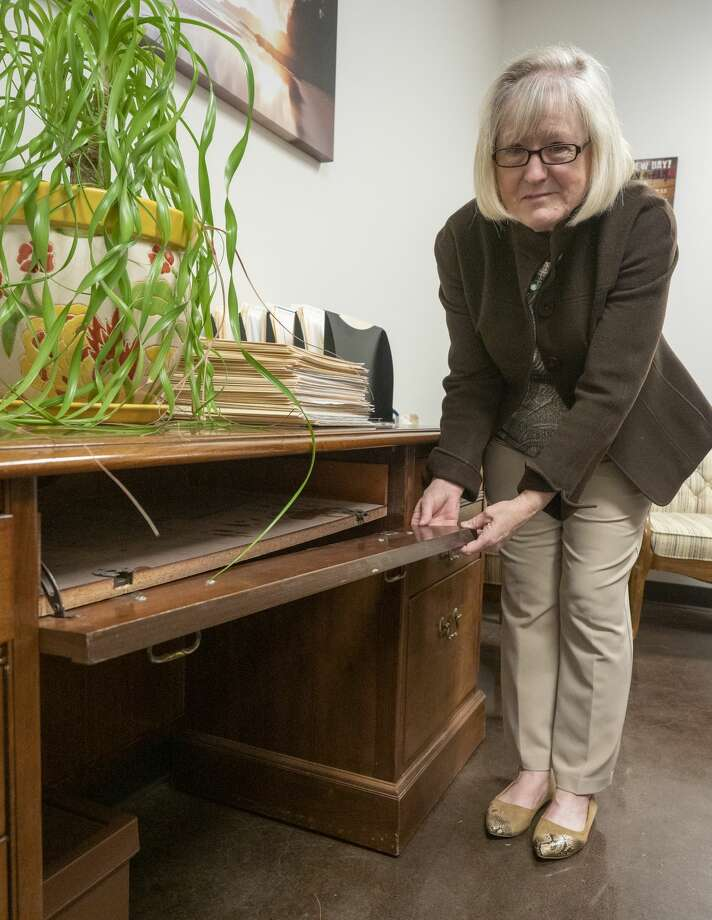 Kay Crites, executive director of Big Brothers Big Sisters of the Permian Basin, shows off a broken desk at the agency's office. While many people who contribute to nonprofits want their donation to go to the people who need it, agencies need to pay the bills. Photo: Tim Fischer/Midland Reporter-Telegram