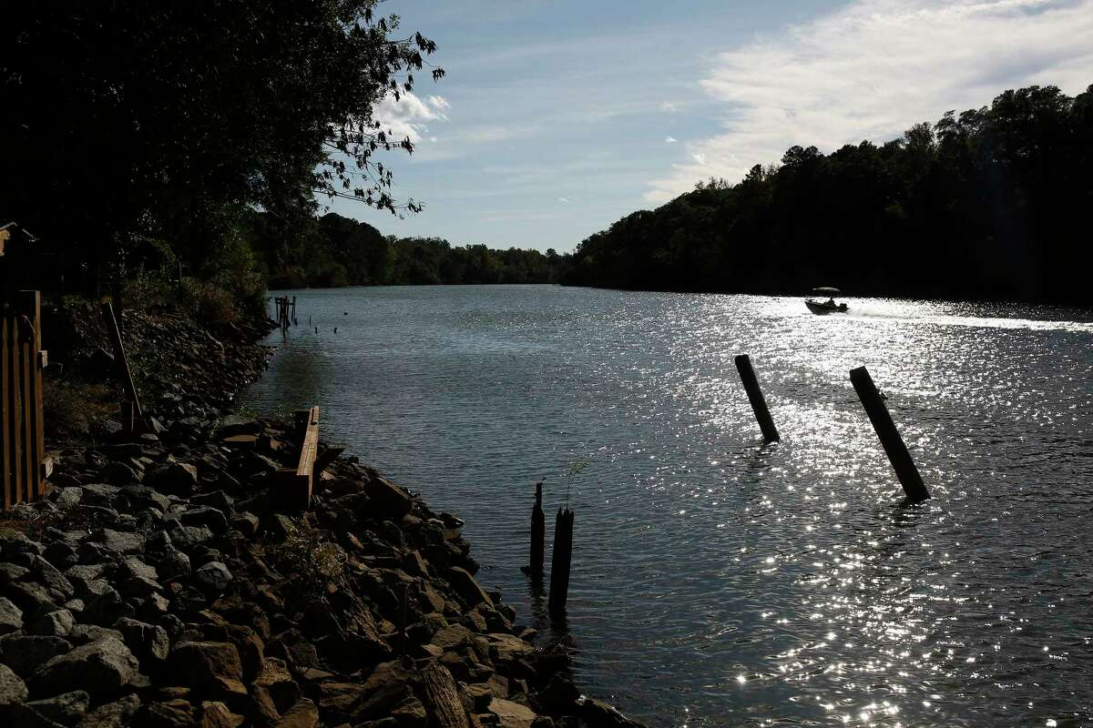 A boat passes what is left of Bill Strain's dock behind his home on the Catawba River in Charlotte, N.C. on Oct. 22. Six feet of water flooded the home after a June storm upstream, and now the former police officer is rebuilding bit by bit.