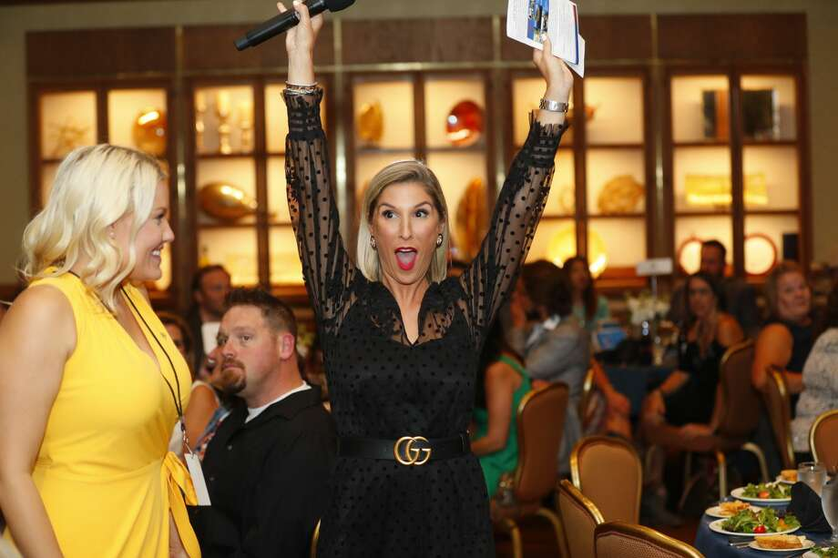 Brittany Hebert, CEO of Sky High, reacts as a live auction item sells during Sky High for Kids banquet Sept. 20 at the Petroleum Club. Photo: Courtesy Of The Oilfield Photographer, Inc.