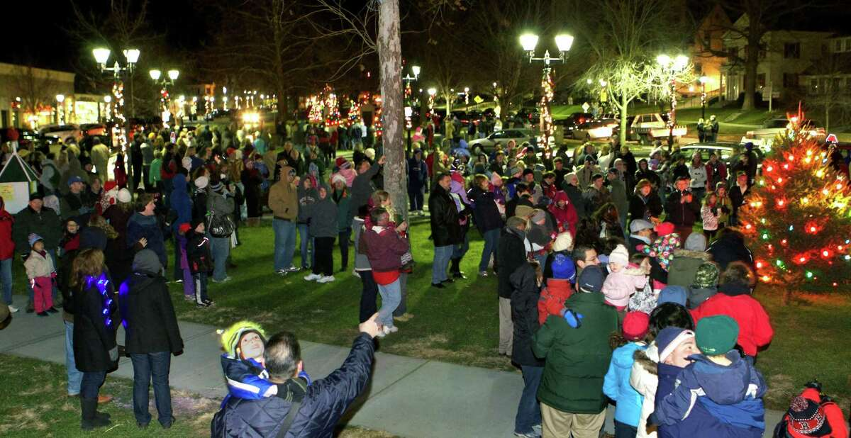 """The lighting the Christmas trees on the Village Green in New Milford has long been a tradition in town as a way to kick off the holiday season. This year's event, sponsored by the Greater New Milford Chamber of Commerce, will mark the 53rd year of the lighting. Residents are invited to gather at the bandstand Nov. 30 at 5:30 p.m. Following the tree lighting, Santa will be available for visits (for more information, see Page S5). Above, a countdown of """"3, 2, 1"""" climaxes with cheers from the crowd as the lights go on on the Christmas trees on the Village Green during the 2012 tree lighting. If you have a """"Flashback"""" photo to share, contact Deborah Rose at drose@newstimes.com or 860-355-7324."""