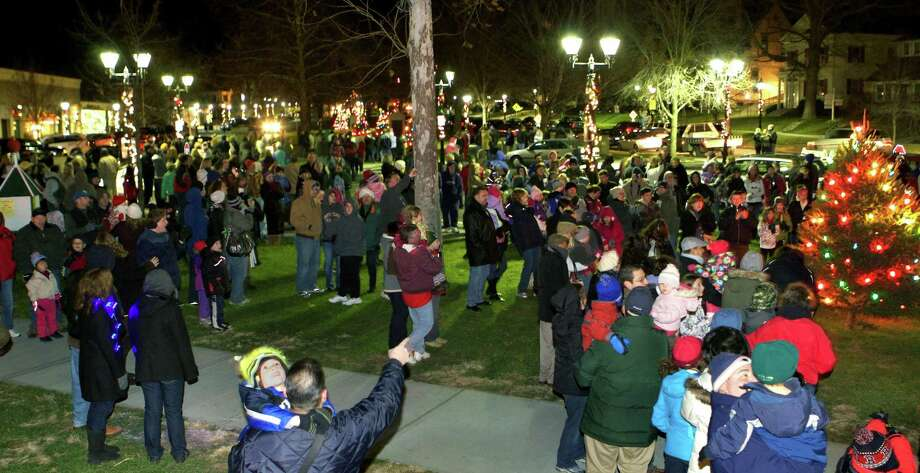 "The lighting the Christmas trees on the Village Green in New Milford has long been a tradition in town as a way to kick off the holiday season. This year's event, sponsored by the Greater New Milford Chamber of Commerce, will mark the 53rd year of the lighting. Residents are invited to gather at the bandstand Nov. 30 at 5:30 p.m. Following the tree lighting, Santa will be available for visits (for more information, see Page S5). Above, a countdown of ""3, 2, 1"" climaxes with cheers from the crowd as the lights go on on the Christmas trees on the Village Green during the 2012 tree lighting. If you have a ""Flashback"" photo to share, contact Deborah Rose at drose@newstimes.com or 860-355-7324. Photo: Trish Haldin / Trish Haldin / Trish Haldin"