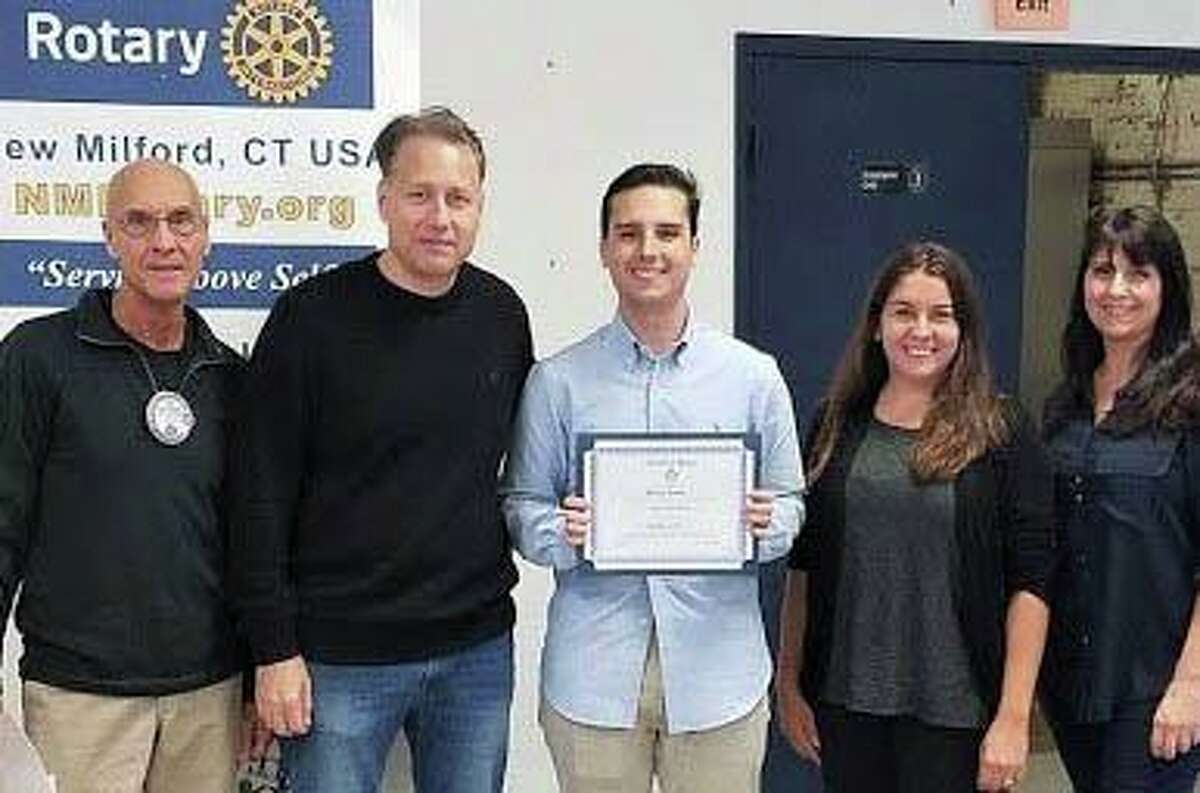 The Rotary Club of New Milford recently presented its October Student of the Month Award to Dylan Leddy. A senior at NMHS, Dylan is a member of the national, math and Spanish honor societies, an AP Scholar with Distinction and a recipient of the Bowdoin College Book Award. He is the founder of the NMHS Investment Club and Computer Science Club and is a math tutor. Dylan served as an intern in the mayor's office and works at The Maxx. His hobbies are golf, politics and computer programming. He plans to study business and computer science in college and work as a computer software developer. Dylan, center, is shown above with, from left to right, Rotarian Tom McSherry, Dylan's dad, Scott Leddy, NMHS teacher Shana Bergonzelli-Graham and Dylan's mom, Andrea Leddy.