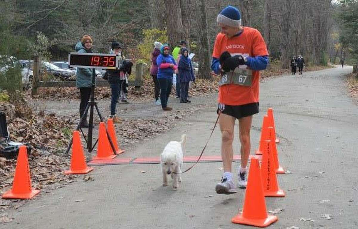 The top male finisher in Glenholme School's recent Run for Autism was Eric Morse of Vermont, shown above with his canine companion at the finish line.