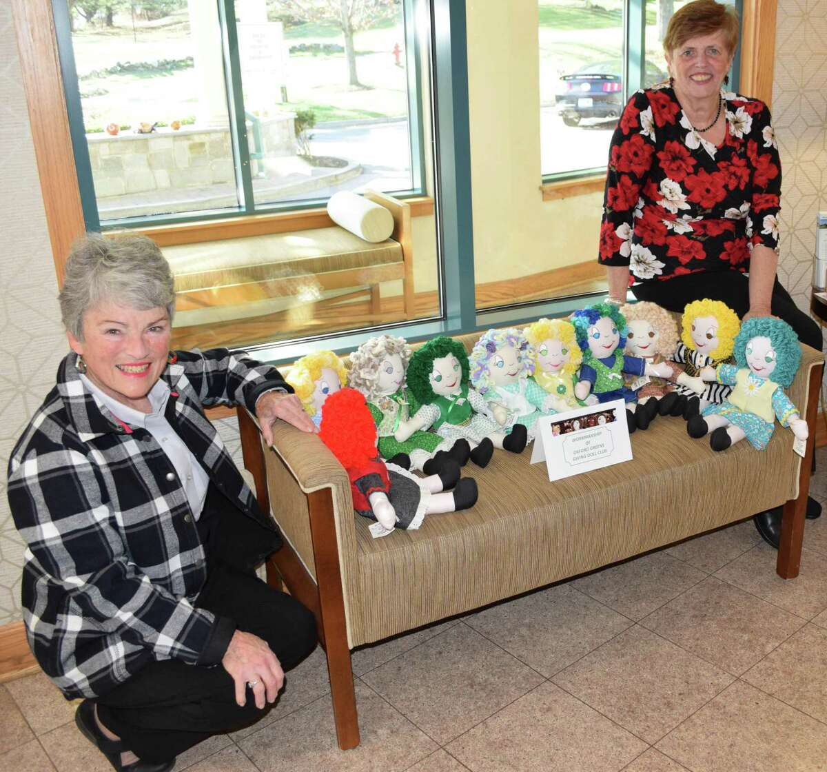Marilyn DeMarche, left, and Pat Dunton, members of The Giving Doll Club, Oxford Greens Chapter, visit Candlewood Valley Health & Rehabilitation to deliver Sunset Dolls to residents.