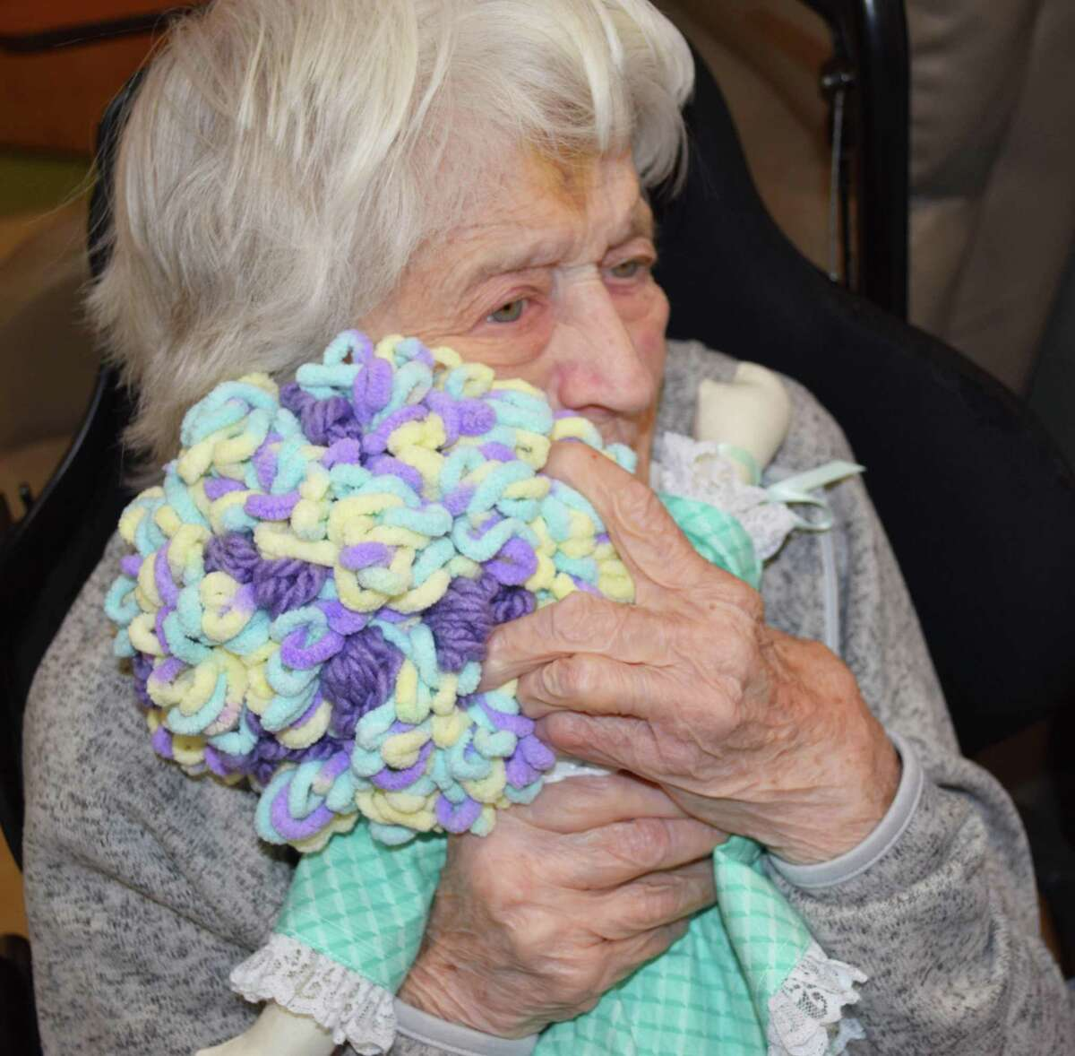 """Spectrum/A number of residents at Candlewood Valley Health & Rehabilitation in New Milford were recently visited by members of The Giving Doll group of Oxford. The members presented residents with handmade dolls. Above, resident Elizabeth """"Betty"""" Osborne hugs her doll. November 2019"""