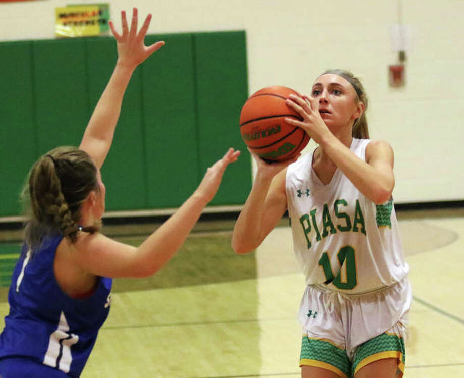 Southwestern's Morgan Durham (right) shoots a 3-pointer over North Greene's Taylor Gilmore on Nov. 20 in Piasa. Durham made three 3s and scored a career-high 13 points Monday night in the Piasa Birds' win at the Litchfield Tourney. Photo: Greg Shashack / The Telegraph