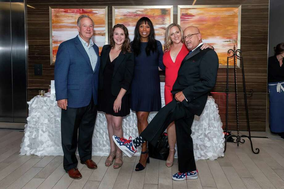 Pictured from left are Larry Abston, Nicole Davis, Vicki Johnson, Michele Shifflett, Brian Brewer at the 2nd Annual Habitat for Heroes Soiree benefiting Habitat for Humanity of Montgomery County on Nov. 11. Photo: Courtesy Photo