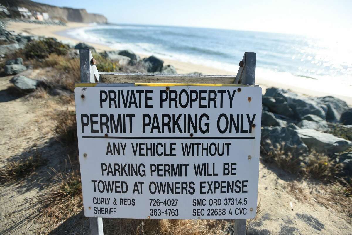 A sign warns of limited parking at Martin's Beach in Half Moon Bay, California on September 19, 2018.