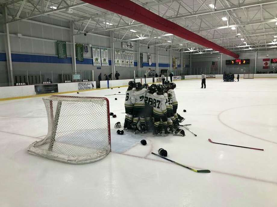 Squirt A Midland Northstars players celebrate after winninga Silver Stick Regional championship on Sunday at the Midland Civic Arena. (Photo provided/Rachel Jingles)