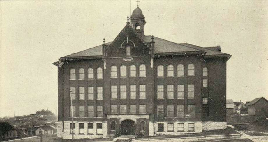 The St. Joseph Catholic School that used to be located behind the church is shown in this 1950s photograph.