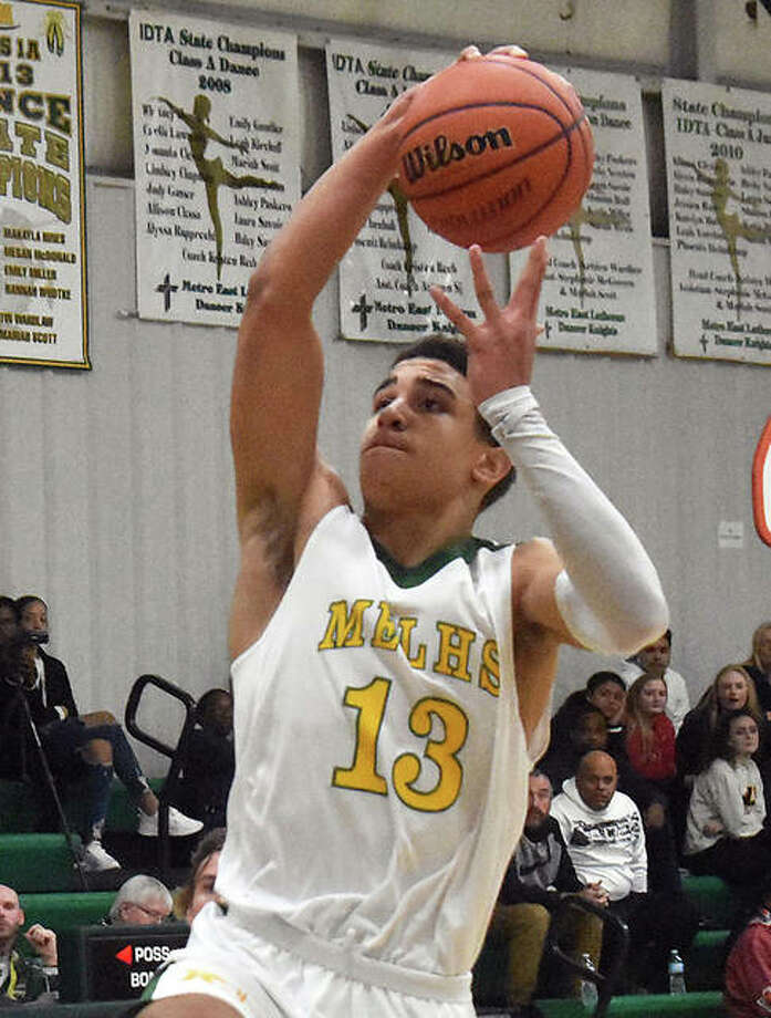 Metro-East Lutheran's A.J. Smith goes up to throw down two of his game-high 20 points Monday night in the Knights' victory over Centralia CORL in the first round of MEL's Thanksgiving Tip-Off Tournament at Hooks Gym in Edwardsville. Photo: Matt Kamp / Hearst Midwest