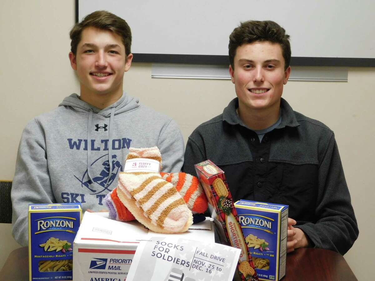 Jake Zeyher, and Jack Savarese with some of the items they are hoping to collect for the Socks for Soldiers holiday drive at Wilton High School, now through Dec. 16.