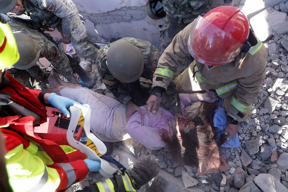 Rescuers pull a survivor from the rubble of a collapsed building in Thumane, after an 6.4 magnitude earthquake was felt across the southern Balkan region. Photo: STRINGER / AFP Via Getty Images