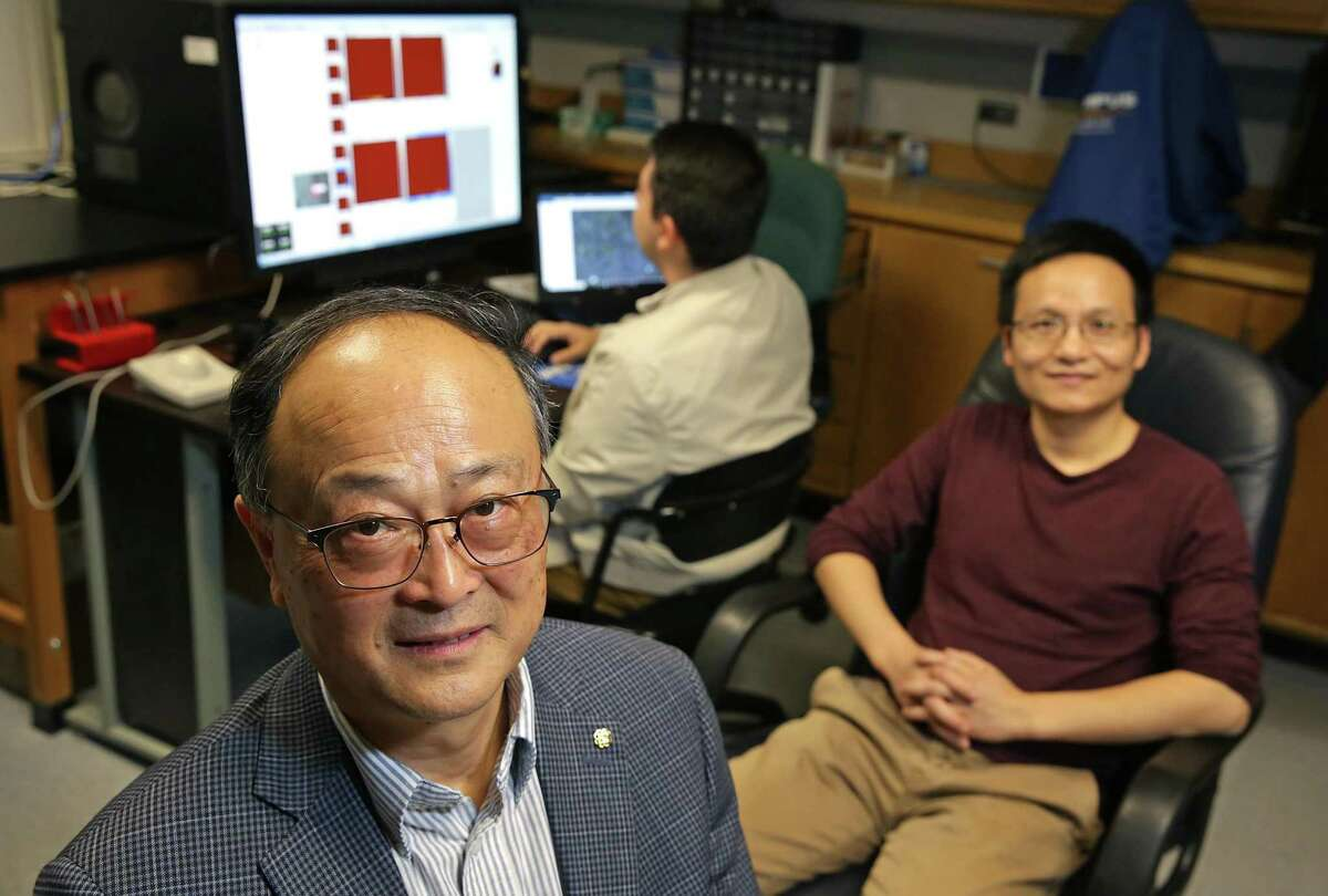 Xiaodu Wang, left, a professor of mechanical and biomedical engineering at the University of Texas at San Antonio, is testing the theory that a type of protein found in bone plays a role in the development of osteoporosis. With him in his lab are Dr. Wei Gao, right, and graduate student Joel Gomez, center.