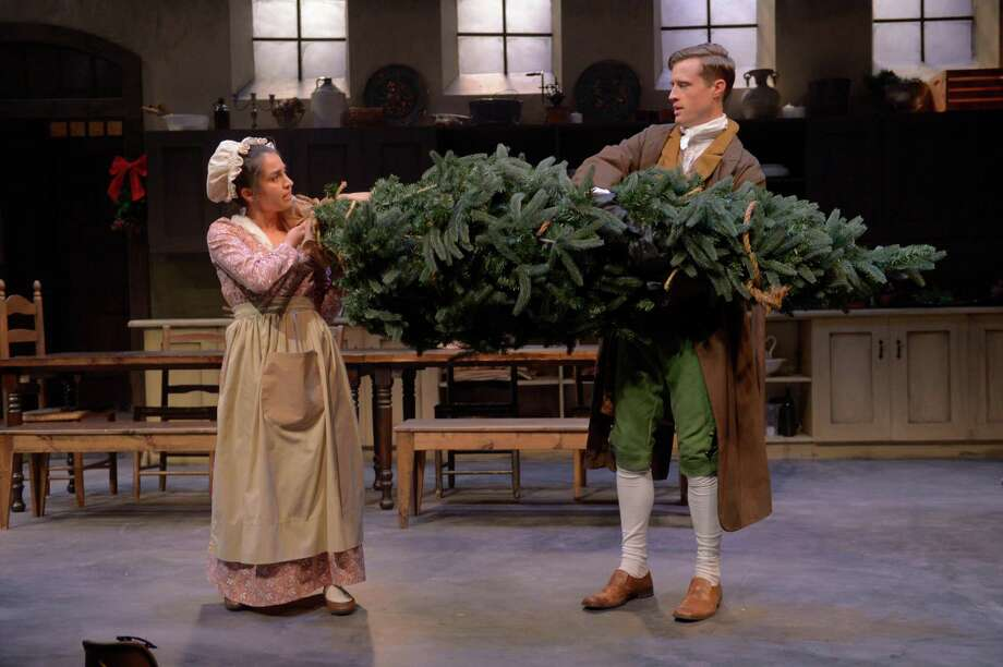 "Cassie (Neiry Rojo, left) and Brian (August Browning) transport Lizzie's Christmas tree upstairs in Marin Theatre Company's ""The Wickhams: Christmas at Pemberley."" Photo: Kevin Berne / Marin Theatre Company"