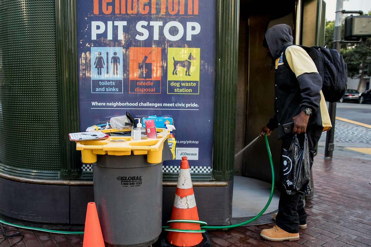 An attendant who declined to be identified cleans out the interior of a 24-hour Pit Stop restroom located on the corner of Eddy and Jones streets in the Tenderloin district of San Francisco, Calif. Friday, Nov. 22, 2019.