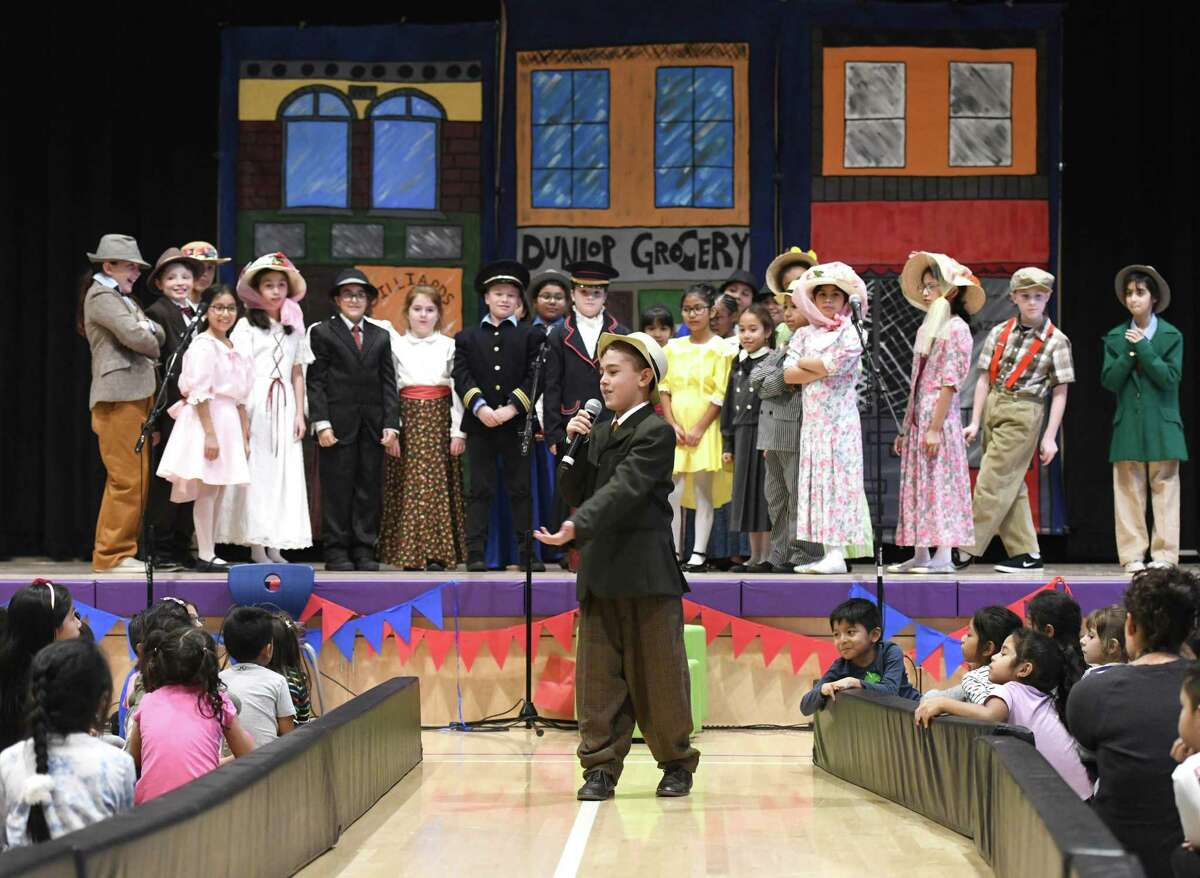 """Bruno Silva plays the role of Harold Hill in the performance of """"The Music Man Kids"""" at New Lebanon School in the Byram section of Greenwich, Conn. Tuesday, Nov. 26, 2019. The story follows salesman Harold Hill as he cons the people of River City, Iowa into buying instruments for a band he vows to organize, but has his heart stolen by the town librarian before he can skip town with the money. Dozens of students had a role in the musical, which was performed in front of the student body Tuesday afternoon and parents and friends Tuesday evening. Proceeds benefit """"The Roots of Music,"""" a New Orleans-based organization that empowers the youth of their city through music education, academic support and mentorship."""