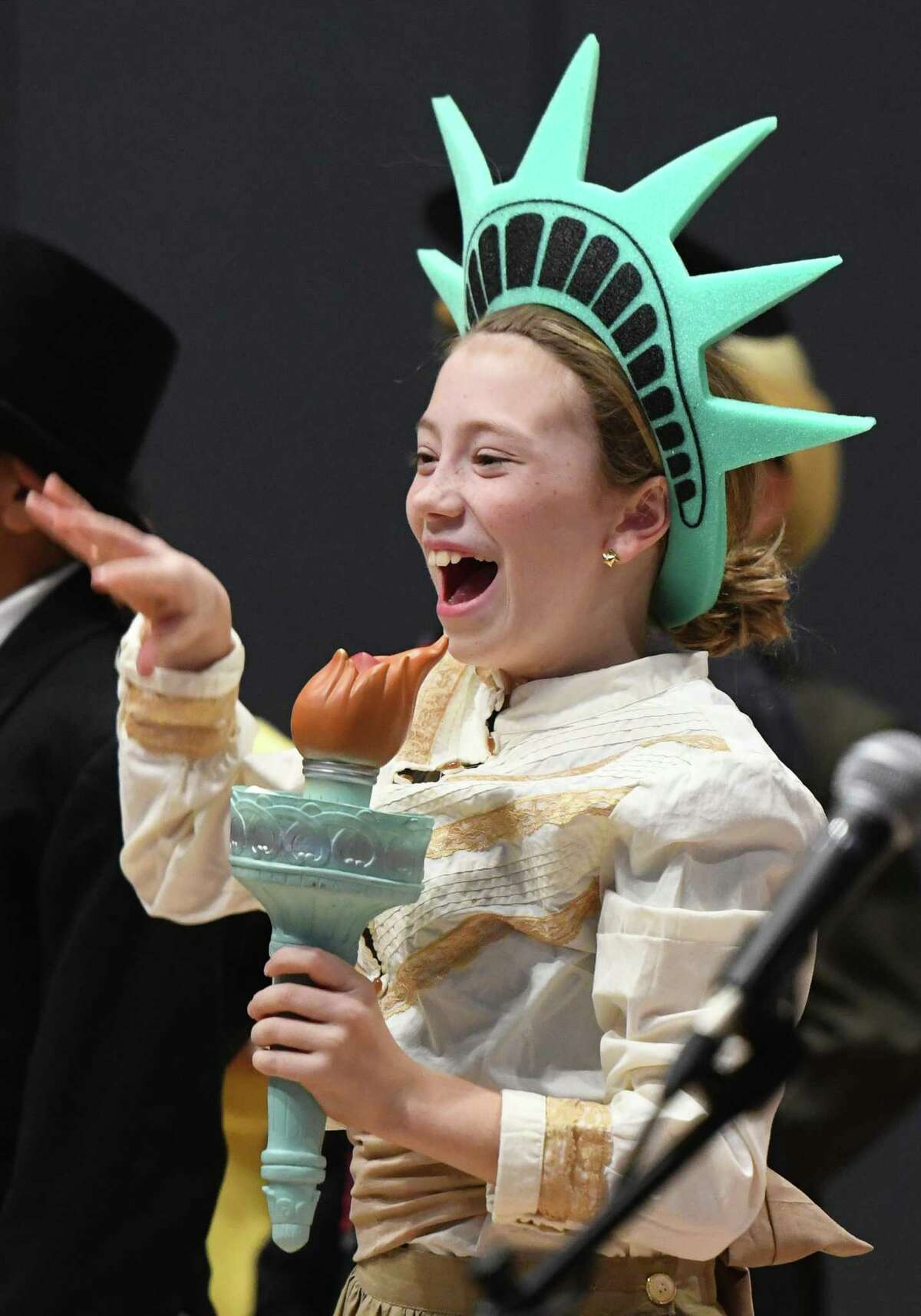 """Sailor Wood-Smith plays the role of Eulalie Mackecknie Shinn in the performance of """"The Music Man Kids"""" at New Lebanon School in the Byram section of Greenwich, Conn. Tuesday, Nov. 26, 2019. The story follows salesman Harold Hill as he cons the people of River City, Iowa into buying instruments for a band he vows to organize, but has his heart stolen by the town librarian before he can skip town with the money. Dozens of students had a role in the musical, which was performed in front of the student body Tuesday afternoon and parents and friends Tuesday evening. Proceeds benefit """"The Roots of Music,"""" a New Orleans-based organization that empowers the youth of their city through music education, academic support and mentorship."""