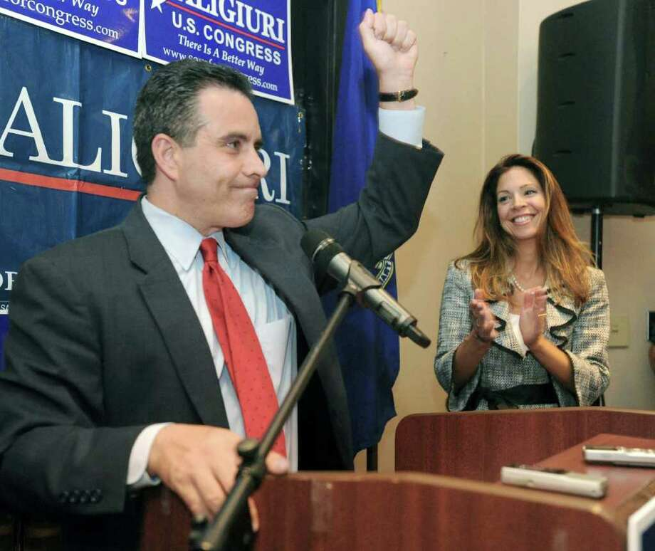 Sam Caligiuri, with his wife, Lori, addresses a crowd at the Holiday Inn in Waterbury after winning the Republican Primary in the 5th Congressional district Tuesday night. Photo: Carol Kaliff / The News-Times