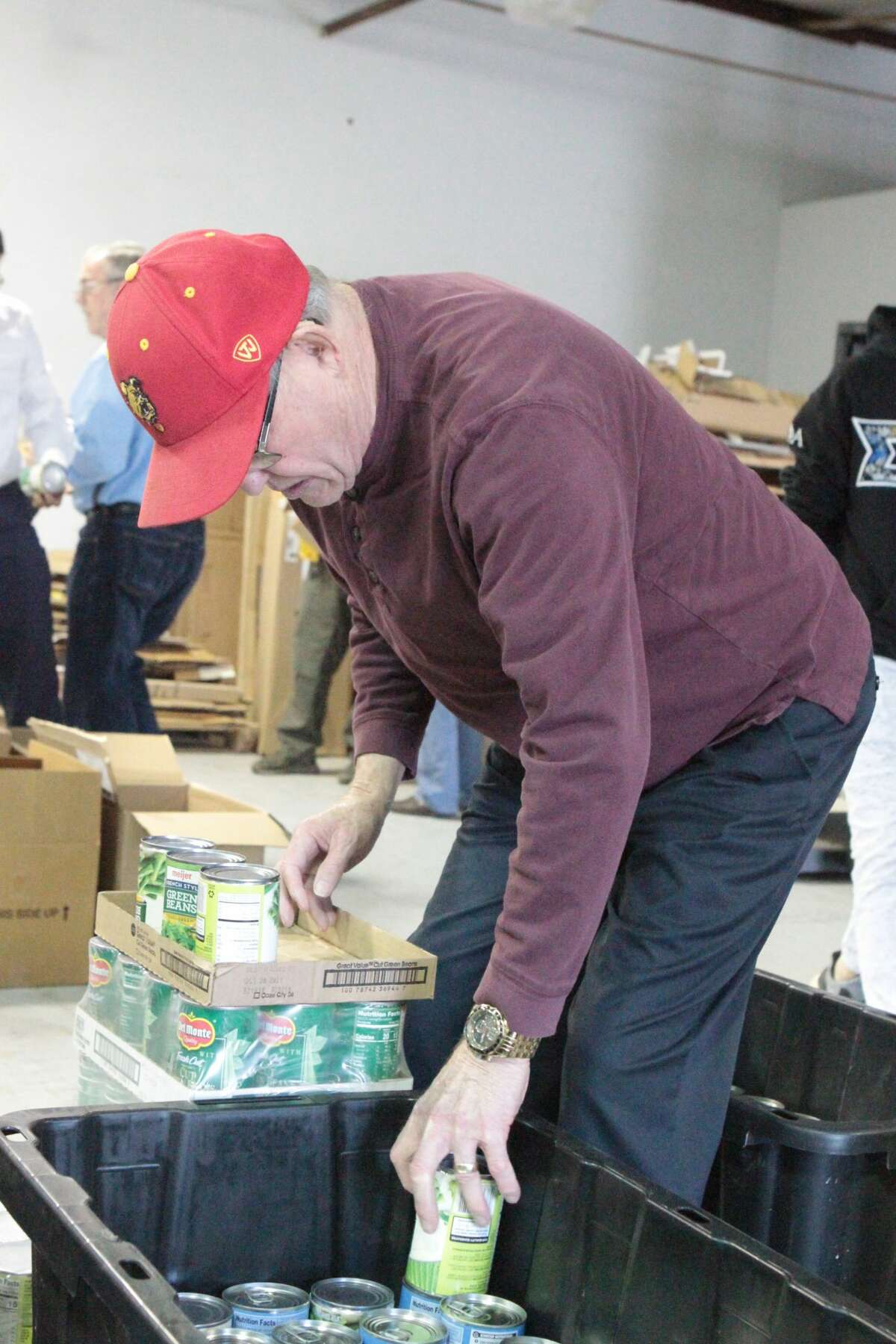Volunteers with the Rotary Club of Big Rapids and Sigma Alpha Epsilon fraternity from Ferris State University, descended upon the Great Lakes Book and Supply warehouse on Clark Street Tuesday to pack and distribute Thanksgiving care packages for local families.