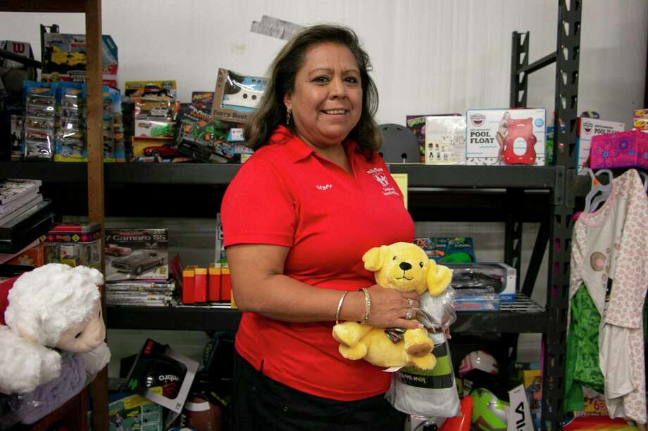 Juanita Zavala, FamilyTime caseworker and outreach coordinator, has been leading their toy drive for over 10 years. The toy drive provides to about 300 people every year to help make the holidays a reality for many families in need. Photo: Savannah Mehrtens/Staff Photo / Savannah Mehrtens/Staff Photo