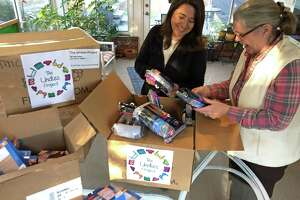 Laura Delaflor and Lucy Langley, co-presidents of the Undies Project in Greenwich, open boxes of men's, women's and children's underwear on Nov. 23. The items were purchased for Bridgeport Rescue Mission and the Thomas Merton Center in Bridgeport.