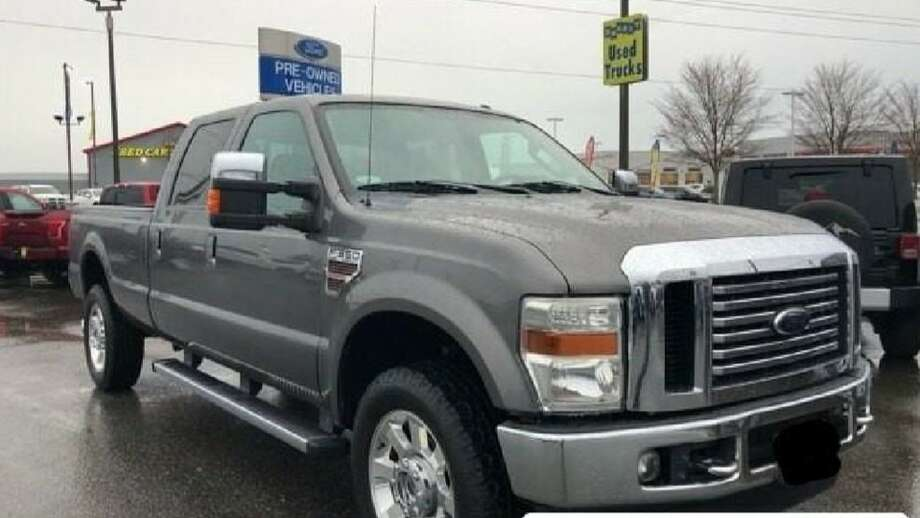 The hit-and-run vehicle is believed to be a 2008-2010 Ford Super Duty F-250, F-350 or F-450 that is possibly dark in color, similar to the one pictured here. Its side mirror came off in the collision. (Photo: Wash. State Patrol) Photo: Photo: Wash. State Patrol