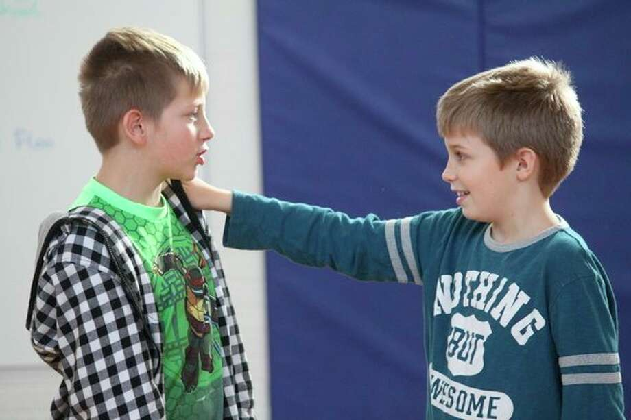 In the gym, students learned various karate moves they could use to protect themselves from bullies. (Pioneer photos/Catherine Sweeney)