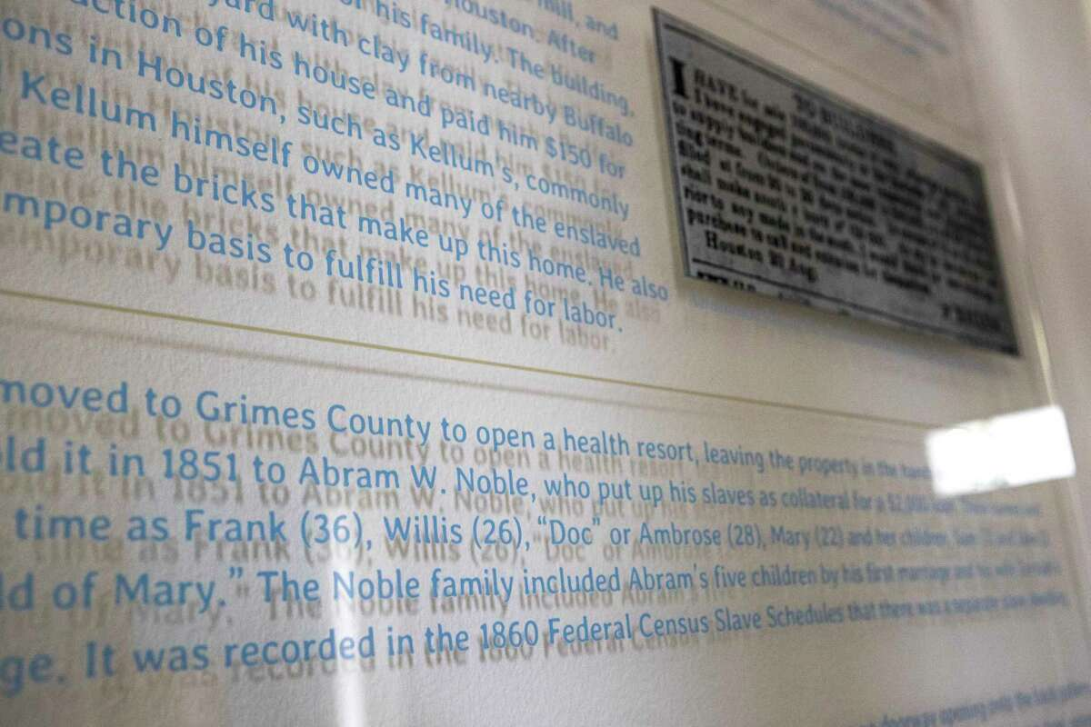 A text panel inside the Kellum-Noble House, highlighting the names and ages of the family's slaves, is shown in Sam Houston Park on Friday, Nov. 22, 2019, in Houston. The Nobles came with their own group of slaves, using them as collateral when they bought the home, so their names were listed in the deed and property transactions: Frank, 36; Willis, 26;
