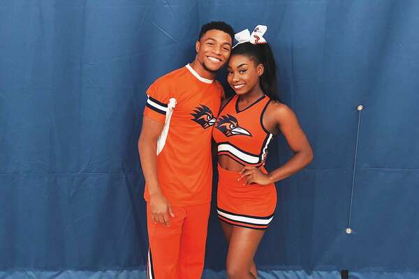 Tyriq Kuykendall, left, is seen in the photo with one of his teammates. Last Saturday, the University of Texas-San Antonio Cheerleader tumbled his way 100 yards in a video that has become viral.
