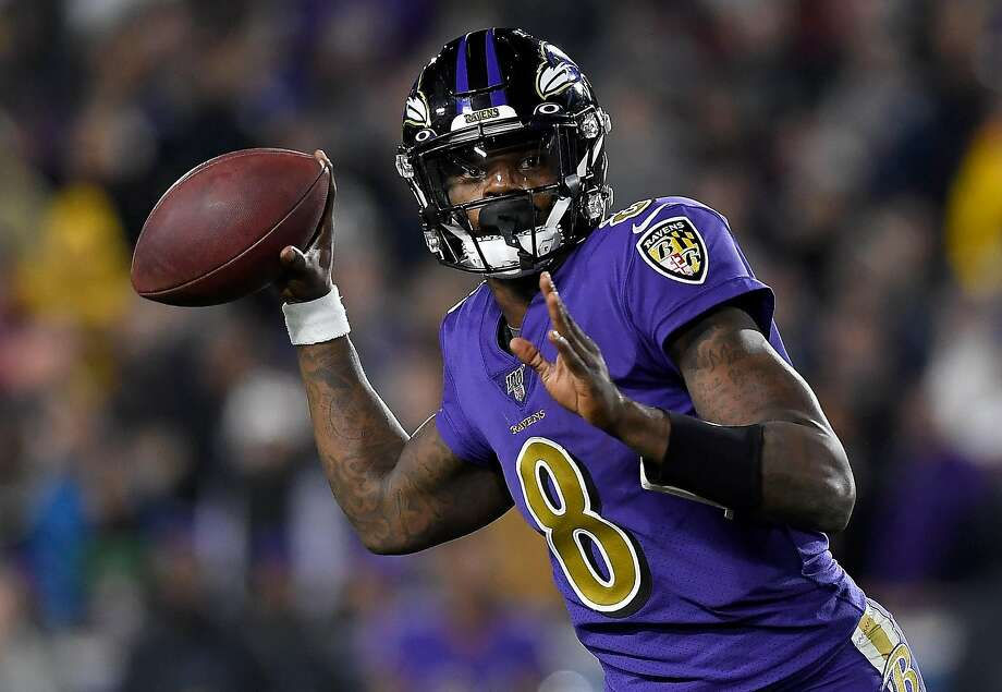 LOS ANGELES, CALIFORNIA - NOVEMBER 25:  Quarterback Lamar Jackson #8 of the Baltimore Ravens looks to deliver a pass over the defense of the Los Angeles Rams at Los Angeles Memorial Coliseum on November 25, 2019 in Los Angeles, California. (Photo by Kevork Djansezian/Getty Images) Photo: Kevork Djansezian / Getty Images