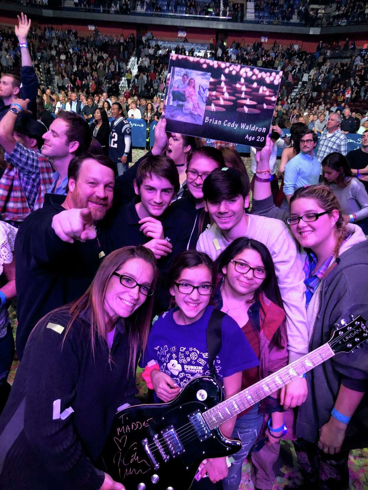 The Morrisseys at a Keith Urban benefit concert and a signed guitar from Urban.