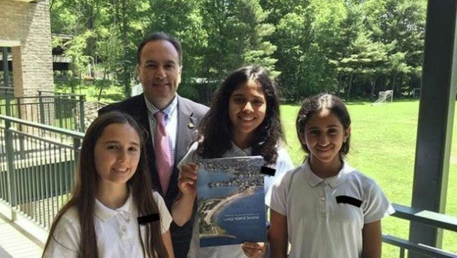 The founders of Greenwich Bottles No More are three students at Whitby School Kira Ferenc, Anika Bhat and Saachi Bogavelli, who are shown with Greenwich First Selectman Peter Tesei. Photo: Contributed /