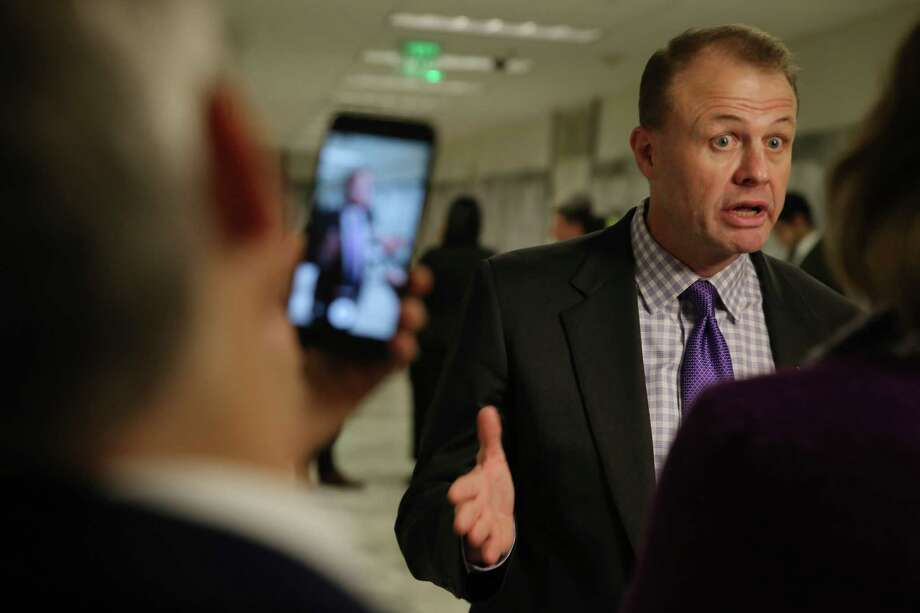 Tim Eyman speaks to media outside the courtroom during a hearing where a coalition of counties, transportation agencies and the city of Seattle argued in front of a King County Superior Court judge for a motion to block Eyman's Initiative 976 from taking effect Dec. 5, saying there would be irreparable harm, that it was unconstitutional and violated the single-subject rule, Tuesday, Nov. 26, 2019. Photo: Genna Martin, Seattlepi.com / GENNA MARTIN
