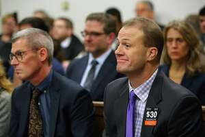 Tim Eyman, right, listens to arguments during a hearing where a coalition of counties, transportation agencies and the city of Seattle argued in front of a King County Superior Court judge for a motion to block Eyman's Initiative 976 from taking effect Dec. 5, saying there would be irreparable harm, that it was unconstitutional and violated the single-subject rule, Tuesday, Nov. 26, 2019.