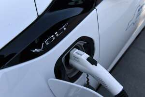 A Chevrolet Volt is plugged into one of the new electric vehicle charging stations on top of the Riverfront Garage on Tuesday, Nov. 26, 2019, Albany, N.Y. (Will Waldron/Times Union)